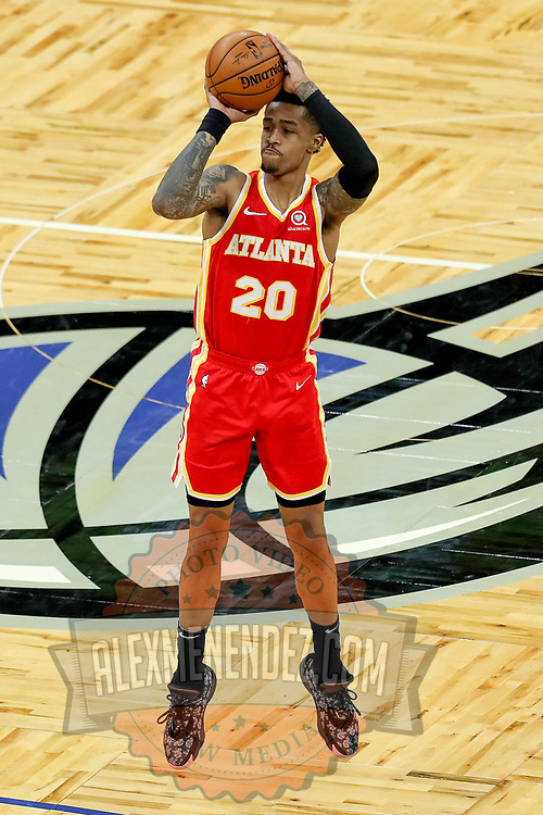 ORLANDO, FL - MARCH 03: John Collins #20 of the Atlanta Hawks attempts a shot against the Orlando Magic at Amway Center on March 3, 2021 in Orlando, Florida. NOTE TO USER: User expressly acknowledges and agrees that, by downloading and or using this photograph, User is consenting to the terms and conditions of the Getty Images License Agreement. (Photo by Alex Menendez/Getty Images)*** Local Caption *** John Collins