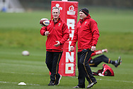 Robert Howley, the Wales coach (l) chats to Neil Jenkins, the Wales assistant coach during the Wales Rugby team training at the Vale Resort, Hensol near Cardiff, South Wales on Wednesday 8th March 2017. The team are preparing for the the RBS Six nations match against Ireland.  pic by  Andrew Orchard, Andrew Orchard sports photography.