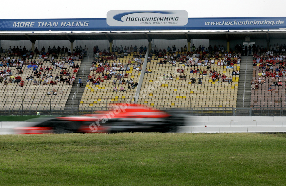 A blurred Christijan Albers (Midland-Toyota) during Friday's practice for the 2006 German Grand Prix at Hockenheim. Photo: Grand Prix Photo