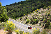Red Car Driving Along San Marcos Pass  in the Santa Ynez Mountains
