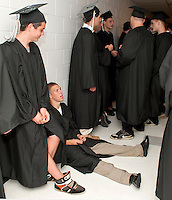 For Andrew Kim and Scott Kanash graduating from Prospect Mountain High School is sinking in as they line up to march into the auditorium for Commencement Friday evening.  (Karen Bobotas/for the Concord Monitor)