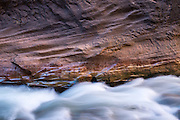 The Virgin River cuts through stone at The Narrows in Zion National Park, Utah.