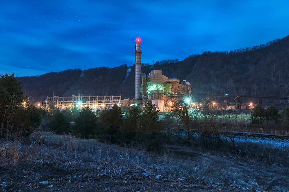 The Kanawha River power plant, shut down since 2015, is seen on a moonlit night in Glasgow, W,Va.