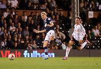 Bolton Wanderers' Dean Moxey shields the ball from Fulham's Patrick Roberts<br /> <br /> Photographer Ashley Western/CameraSport<br /> <br /> Football - The Football League Sky Bet Championship - Fulham v Bolton Wanderers - Wednesday 01st October 2014 - Craven Cottage - London<br /> <br /> © CameraSport - 43 Linden Ave. Countesthorpe. Leicester. England. LE8 5PG - Tel: +44 (0) 116 277 4147 - admin@camerasport.com - www.camerasport.com