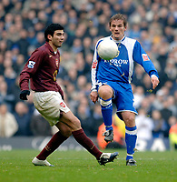 Photo: Daniel Hambury.<br />Arsenal v Cardiff City. The FA Cup. 07/01/2006.<br />Arsenal's Jose Antonio Reyes (L) and Cardiff's Neal Ardley battle for the ball.