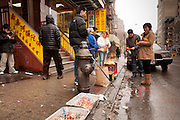 Burning mock money outside the True Buddha Temple on Manhattan's East Broadway to bring good fortune to ancesteors.