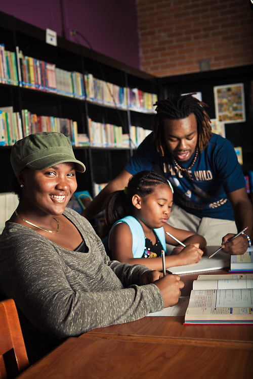 18 August 2011- Rochae Harris (green hat), Taz Evans (blue bacpack), and mentor Tater are photographed at the Hope Center for Family Spectrum Magazine.