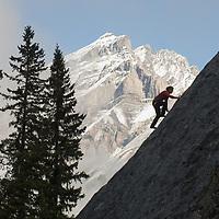 Sasha Ruttan climbs a face at Rundle Rock, below Cascade Mountain, near Banff, Alberta, in Canada's Banff National Park.