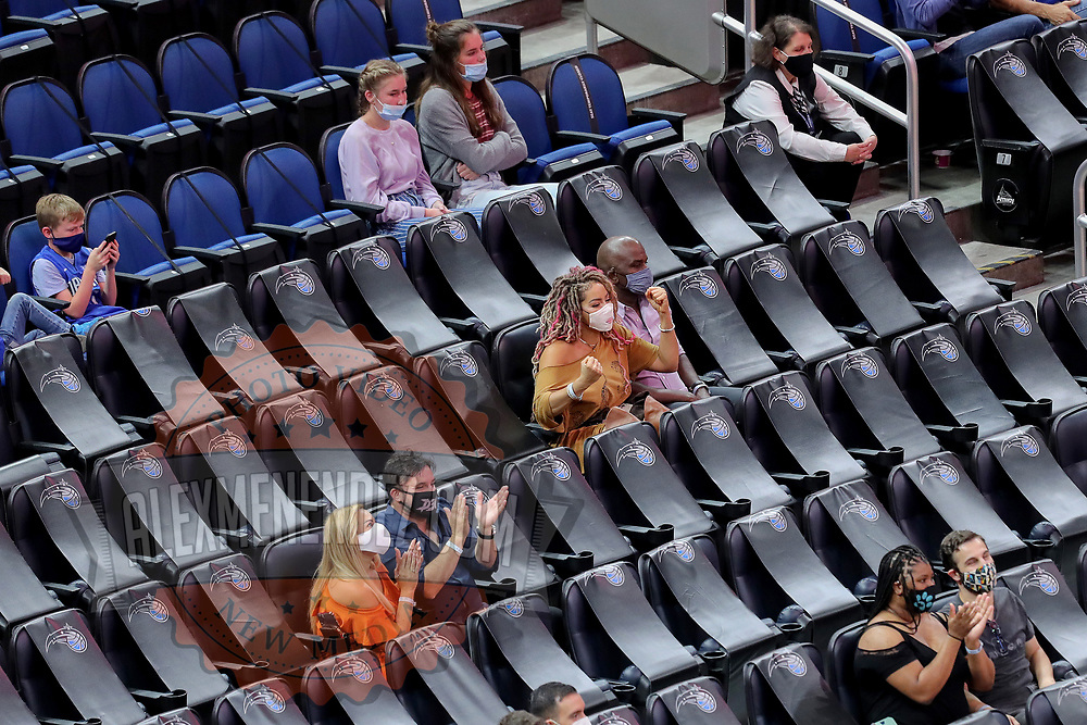 ORLANDO, FL - MARCH 24: Socially distanced fans watch the Phoenix Suns play the Orlando Magic at Amway Center on March 24, 2021 in Orlando, Florida. NOTE TO USER: User expressly acknowledges and agrees that, by downloading and or using this photograph, User is consenting to the terms and conditions of the Getty Images License Agreement. (Photo by Alex Menendez/Getty Images)*** Local Caption ***
