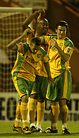Photo: Aidan Ellis.<br /> Rochdale v Norwich City. Carling Cup. 28/08/2007.<br /> Norwich's Dion Dublin celebrates his equaliser with Darren Huckerby and Julian Brellier