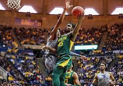 Mar 7, 2020; Morgantown, West Virginia, USA; Baylor Bears guard Davion Mitchell (45) shoots against West Virginia Mountaineers guard Miles McBride (4) during the first half at WVU Coliseum. Mandatory Credit: Ben Queen-USA TODAY Sports