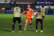 Marine forward Niall Cummins (9) celebrates with Marine goalkeeper Bayleigh Passant (1) during the The FA Cup match between Marine and Havant & Waterlooville FC at Marine Travel Arena, Great Crosby, United Kingdom on 29 November 2020.