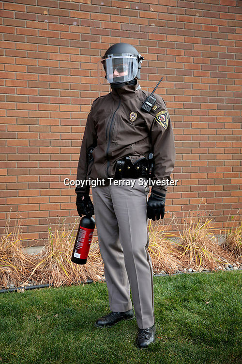 A police officer carries a can of pepper spray during a protest against the Dakota Access oil pipeline on November 14, 2016. Bismarck, North Dakota, United States.