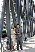 A young couple,  wearing the fashion of the 1920s, have their wedding portraits taken while standing on Garden Bridge (Waibaidu Bridge) in Shanghai, China on 26 June 2009.