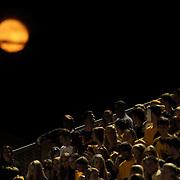 The moon rises over Topsail High School Football stadium.