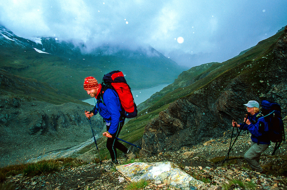 Hiking the Haute Route in a summer snowstorm, near Cabane des Dix, Switzerland