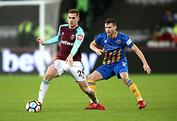 West Ham United's Toni Martinez (left) and Shrewsbury Town's Mat Sadler (right) battle for the ball during the FA Cup Replay at the London Stadium.