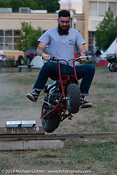 Trey Burke jumping his minibike in the makeshift downtown campground during the Run to Raton. Raton, NM. USA. Saturday July 21, 2018. Photography ©2018 Michael Lichter.