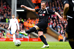 Charlie Adam fires a shot towards goal    - Photo mandatory by-line: Matt McNulty/JMP - Mobile: 07966 386802 - 29/03/2015 - SPORT - Football - Liverpool - Anfield Stadium - Gerrard's Squad v Carragher's Squad - Liverpool FC All stars Game