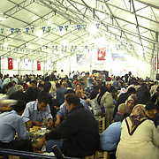 People breaking their fast at the tent donated by the Eminonu Shop Owners Associtaion and Eminonu Municipality at the first day of Ramadan which is the holly fasting  season for the Muslims.   Saturday, 23.09.2006<br /> Photo by Ahmet DUMANLI/TURKPIX