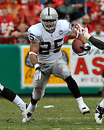 Running back Justin Fargas (25) of the Oakland Raiders rushes up field in the second quarter against the Kansas City Chiefs at Arrowhead Stadium in Kansas City, Missouri on September 14, 2008.....