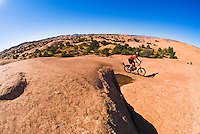 Mountain biker riding the Slickrock Bike Trail out of Moab, Utah