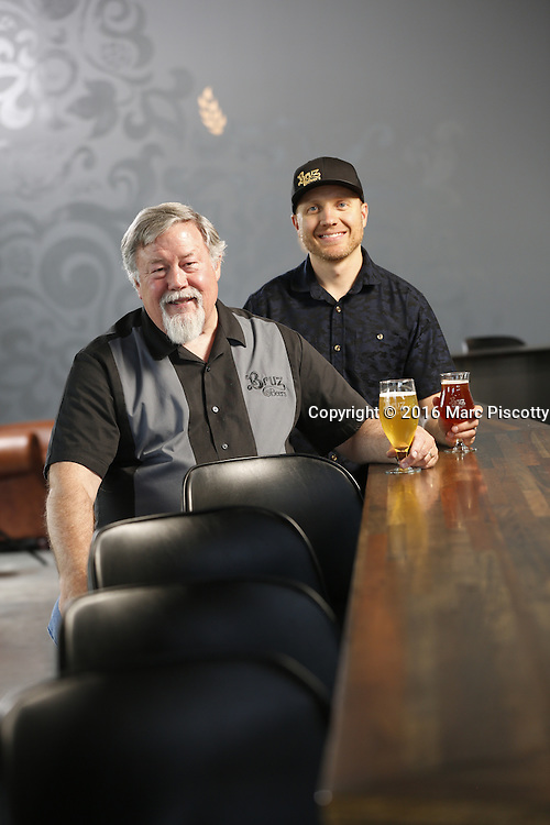 SHOT 7/22/16 1:59:00 PM - Bruz Beers co-founders Charlie Gottenkieny and Ryan Evans inside the new brewery near 67th Avenue and Pecos in Denver, Co. Bruz Beers is Denver's artisanal Belgian-style brewery, featuring a full line of traditional and Belgian-inspired brews, hand-crafted in small batches. Includes images of Evan's dog 'Cooper' as well who serves as the brewery dog. (Photo by Marc Piscotty / © 2016)