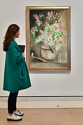 """© Licensed to London News Pictures. 01/08/2017. London, UK. A visitor views """"Lilacs"""", 1914.  Preview of """"Matisse in the Studio"""", at the Royal Academy of Arts, Piccadilly, the first exhibition to consider how the personal collection of treasured objects of Henri Matisse were both subject matter and inspiration for his work.  Around 35 objects are displayed alongside 65 of Matisse's paintings, sculptures, drawings, prints and cut-outs.  The exhibition runs 5 August to 12 November 2017.  Photo credit : Stephen Chung/LNP"""
