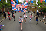 Neighbours and friends in Desenfans Road, Dulwich south London, celebrate the royal wedding of Prince William and Kate Middleton (now called the Duke and Duchess of Cambridge). Across the UK, 5,500 formal road closures (825 in London) were arranged with local authorities and residents held traffic-free events, the like of which haven't been seen since the ill-fated wedding of Charles and Diana in 1981 – in the traditions of Victorian and end of war eras.