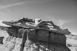 male nude on a rock formation