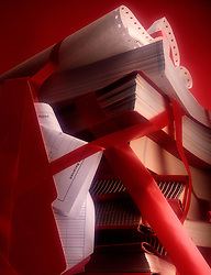 Cluttered assortment business documents wrapped in red tape. CONCEPT STOCK PHOTOS CONCEPT STOCK PHOTOS CONCEPT STOCK PHOTOS
