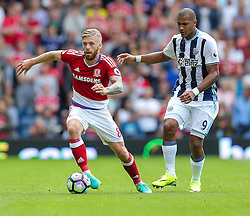 Adam Clayton of Middlesbrough is challenged by Jose Salomon Rondon of West Bromwich Albion - Rogan Thomson/JMP - 28/08/2016 - FOOTBALL - The Hawthornes - West Bromwich, England - West Bromwich Albion v Middlesbrough - Premier League.