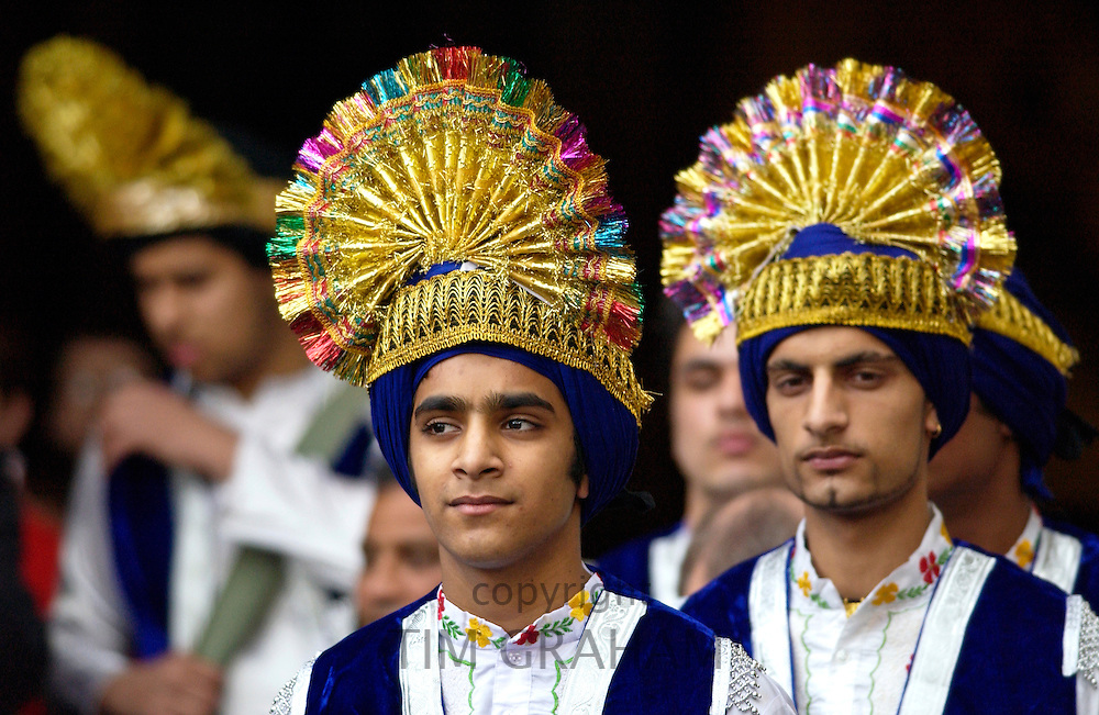 """Two participants wearing costumes created to represent this year's theme for the Observance for Commonwealth Day Service which is """"Partners in Development"""".  The Commonwealth Heads of Government designated the second Monday in March as Commonwealth Day so that young people in particular could learn about and mark the Day during their school term."""