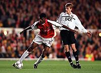 Kanu (Arsenal) Anatoliy Tymoshchuk (FC Shakhar Donetsk). Arsenal 3:2 FC Shakhar Donetsk, UEFA Champions League, Group B, 20/9/2000. Credit Colorsport / Stuart MacFarlane.