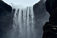 Skógafoss watefall during a winter storm, South Iceland.
