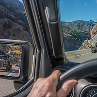 Traffic negotiates a cliffy section of US Highway 550 near Ouray, Colorado, a feat of engineering called the Million Dollar Highway.