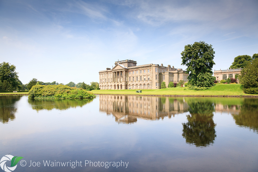 Reflected in its peaceful lake, Lyme Park is famed as one of the locations used in the popular TV series Pride and Prejudice.  It more recently played a starring role in the horror film The Awakening. Photographed in July 2012.