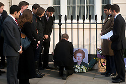 © Licensed to London News Pictures. 08/04/2013. London, UK. Members of Young Conservatives with flowers at the house where former Conservative Prime Minister Margaret Thatcher lived in central London. Lady Thatcher dies this mooring from a suspected stroke..Photo credit : Peter Kollanyi/LNP