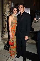 Rower JAMES CRACKNELL and TV presenter BEVERLEY TURNER at the 2004 British Fashion Awards held at Thhe V&A museum, London on 2nd November 2004.<br />
