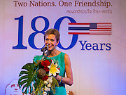 19 JULY 2013 - BANGKOK, THAILAND:    KRISTIE KENNEY, the US Ambassador to Thailand, speaks about US-Thai relations at the opening of a photo exhibit sponsored by the US Embassy in Bangkok. The photo exhibit celebrates 180 years of US-Thai diplomatic relations. There are 180 photos hanging in the show, 90 by American photographers in Thailand and 90 by Thai photographers in the United States. The show, which opened July 19, is hanging in CentralWorld, a large mall in Bangkok, and is touring Thailand when it concludes its Bangkok run on July 21.  PHOTO BY JACK KURTZ