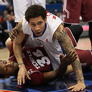Nic Moore, (top), SMU, tangles with Devin Coleman, Temple, during the Temple Vs SMU Semi Final game at the American Athletic Conference Men's College Basketball Championships 2015 at the XL Center, Hartford, Connecticut, USA. 14th March 2015. Photo Tim Clayton
