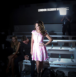 © Licensed to London News Pictures. 15/09/2012. London, UK.  Kelly Brook  with boyfriend Thom Evans at Issa London catwalk show at London Fashion Week Spring/Summer 2013 on September 15, 2012. Photo credit : Ben Cawthra/LNP