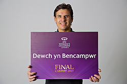 "CARDIFF, WALES - Monday, November 7, 2016: Wales' manager Chris Coleman holds up a board ""Dewch yn Bencampwr"" to encourage people to become volunteers for the 2017 UEFA Champions League Final in Cardiff. (Pic by David Rawcliffe/Propaganda)"