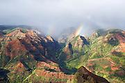 Afternoon light and double rainbows over Waimea Canyon, in Waimea Canyon State Park, Kauai, Hawaii.