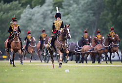 © Licensed to London News Pictures. 02/06/2015. London, UK. The King's Troop Royal Horse Artillery  ride their horses and gun carriages on to Hyde Park, before staging a 41 Gun Royal Salute in Hyde Park, London to mark the 62nd anniversary of the coronation of Queen Elizabeth II. Photo credit: Sergeant Rupert Frere RLC/LNP