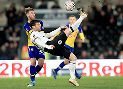 Southampton's Callum Slattery (left) and Derby County's David Nugent battle for the ball during the Emirates FA Cup, third round match at Pride Park, Derby.