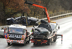 © Licensed to London News Pictures. 03/12/2012 London, UK. Two BMW vehicles are removed from the M1 southbound carriageway between junctions 5 and 4. Two men, the driver and front seat passenger in one of the cars, died at the scene. Photo credit : Simon Jacobs/LNP