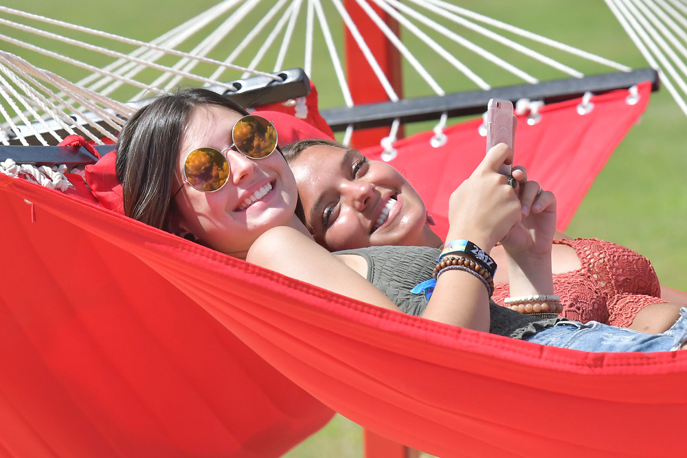 Two Bonaroovians take a rest on one of the many hammocks found throughout The farm during Bonnaroo.