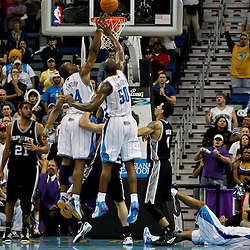 January 23, 2012; New Orleans, LA, USA; New Orleans Hornets power forward Carl Landry (24) tips in a basket missed by point guard Jarrett Jack (2) during the fourth quarter of a game against the San Antonio Spurs at the New Orleans Arena. The Spurs defeated the Hornets 104-102.  Mandatory Credit: Derick E. Hingle-US PRESSWIRE
