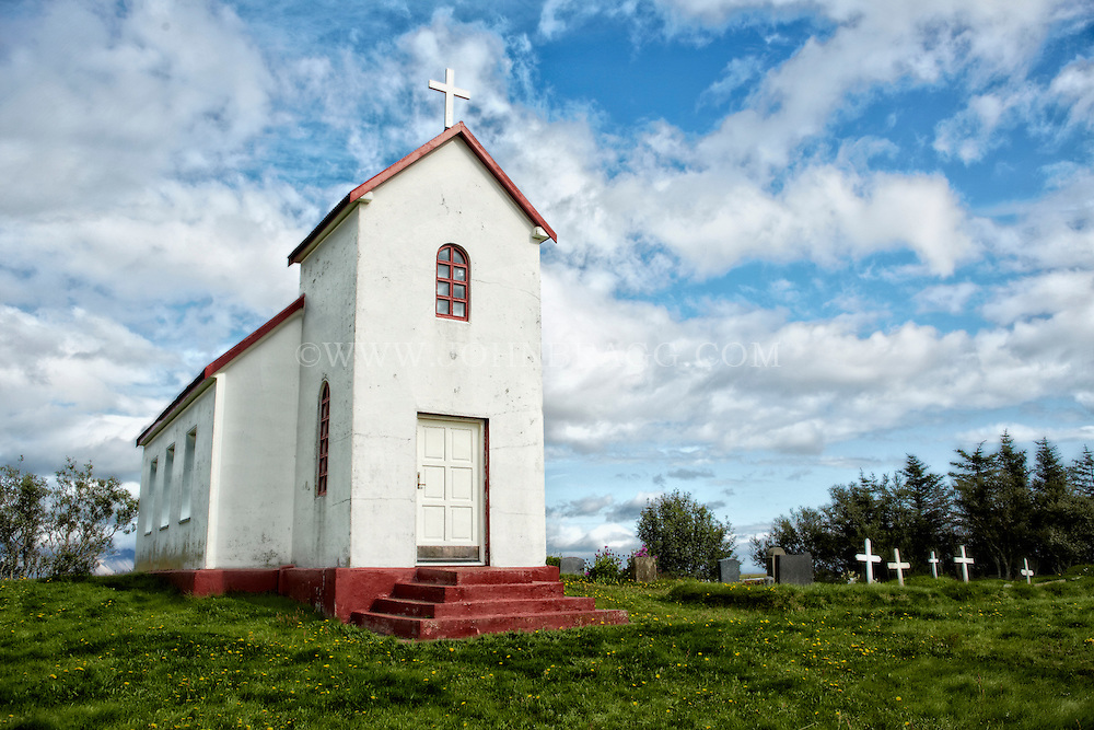Small white and red church in Brunnholl, Iceland